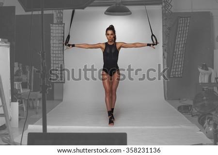 fitness model posing in the studio photography - stock photo