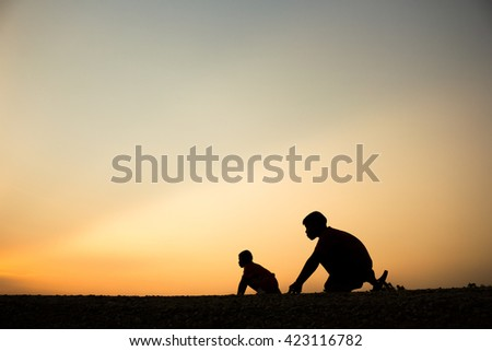 Fitness on silhouette sunrise The boy running workout wellness concept. - stock photo