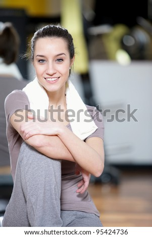 fitness portrait: A young female stays fit. - stock photo