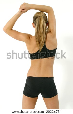 Fitness portrait of a young blond female exercising. - stock photo