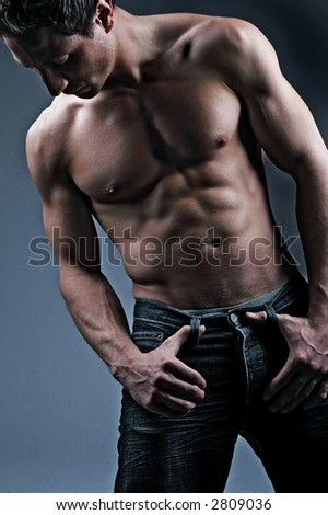 fitness shot of a very fit man - stock photo