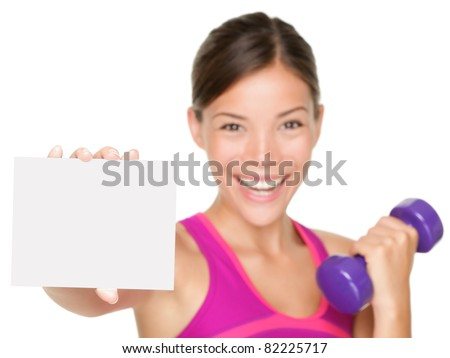 fitness sign woman smiling happy showing empty blank paper sign. Fitness model isolated on white background. - stock photo