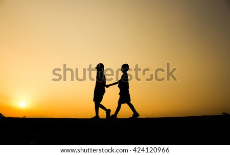 Fitness silhouette sunrise Holding Hands Walking workout wellness concept. - stock photo