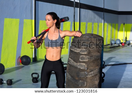 Fitness sledge hammer woman workout at gym relaxed after exercise - stock photo