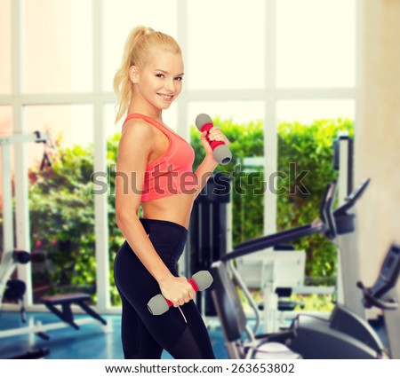 fitness, sport and diet concept - smiling beautiful sporty woman with dumbbells - stock photo
