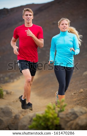 And man jogging on gravel runner couple in nature taking