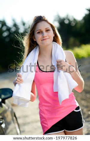 fitness sport healthy and cheerful young woman running outdoor in the countryside with white towel - stock photo