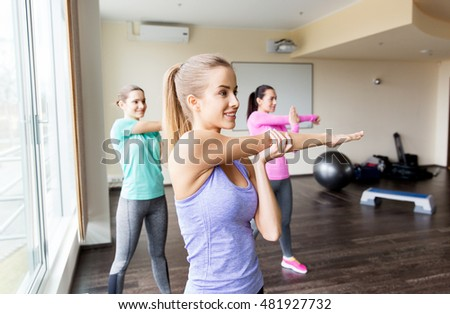 fitness, sport, training, exercising and people concept - group of women working out in gym