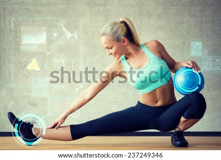 fitness, sport, training, future technology and lifestyle concept - smiling woman with exercise ball in gym over graph projection - stock photo