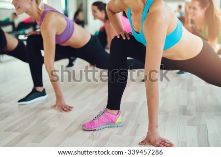 fitness, sport, training, gym and lifestyle concept - close up of people exercising in the gym - stock photo