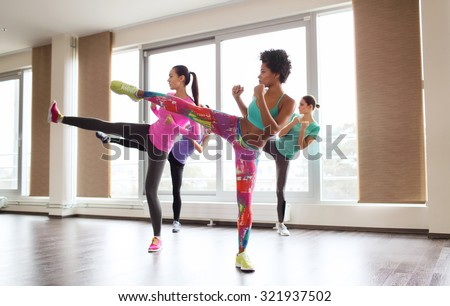 fitness, sport, training, gym and martial arts concept - group of women working out and fighting in gym - stock photo