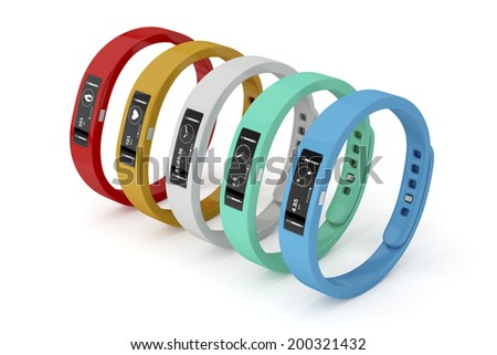 Fitness trackers with different interfaces and colors - stock photo