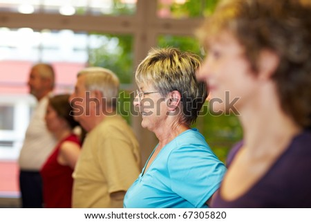 Fitness training for seniors in a gym - stock photo