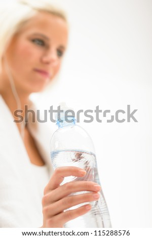 Fitness water bottle woman in background isolated on white - stock photo