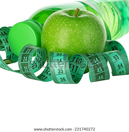 Fitness, weight loss concept with green apples, bottle of drinking water and tape measure isolated on white background - stock photo
