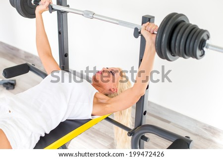 Fitness with young, blond woman - stock photo