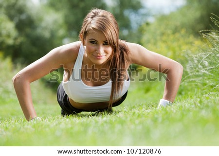 Fitness woman. Beautiful fit woman training to music. Concept sport and fitness - stock photo