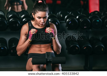 fitness woman doing abdominal crunch in gym woking out