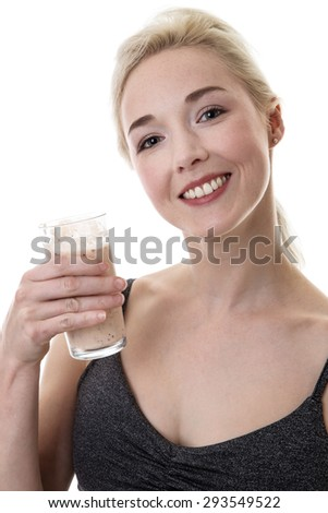 fitness woman drinking a smoothie looking happy  - stock photo