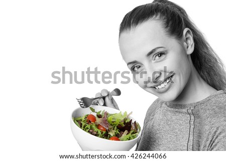 fitness woman eating salad shot in the studio on white background