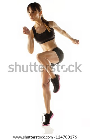 Fitness woman exercising aerobic /Beautiful athlete woman doing fitness exercise - stock photo