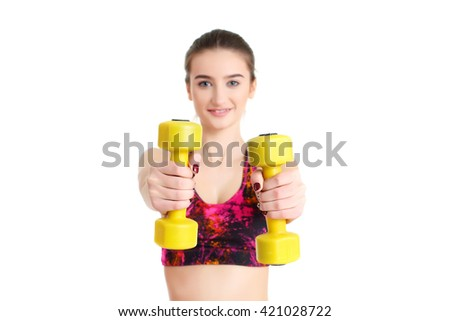Fitness woman exercising crossfit holding dumbbell strength training biceps / photo set of sporty muscular female brunette girl wearing sports clothes working out with dumbbell over white background - stock photo