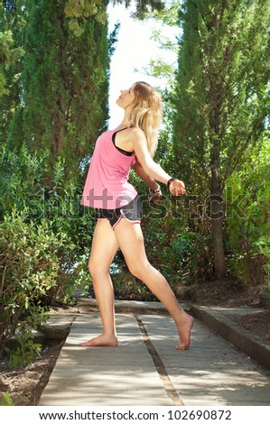 fitness woman in  green park at summer - stock photo