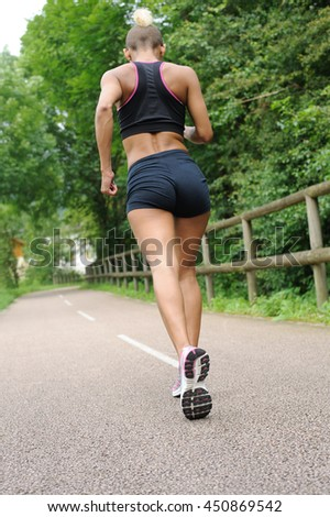 Fitness woman jogging outdoors - stock photo