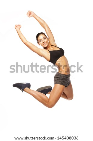 fitness woman jumping of joy. - stock photo