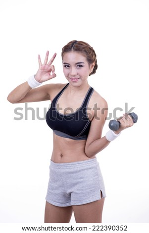 Fitness woman lifting dumbbells isolated on white background.
