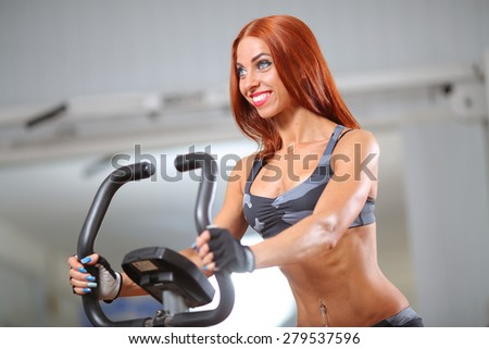 fitness woman on a bike - stock photo