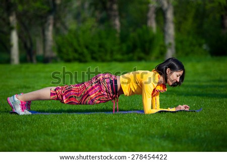 fitness woman on green park, girl, yoga - stock photo