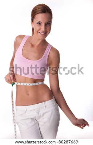 fitness woman on white background measuring her body - stock photo