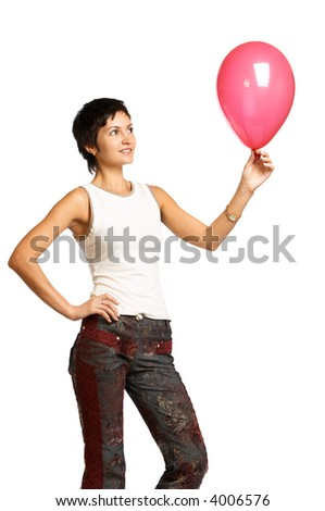 Fitness woman playing with red balloon. Isolated over white background