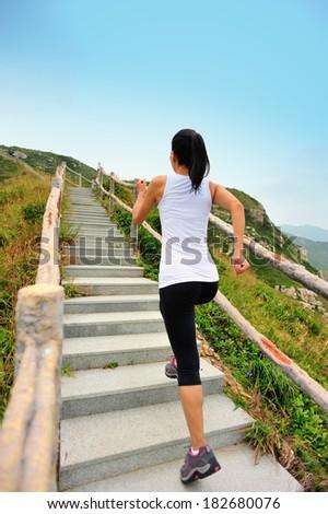 fitness woman running on mountain stairs  - stock photo