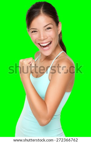 Fitness woman showing fresh energy flexing biceps muscles smiling happy isolated cutout on green chroma key background. Fit mixed race Asian Caucasian female fitness model energetic and fun. - stock photo