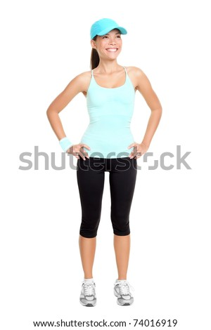Fitness woman standing isolated on white background in full body. Young fresh and healthy mixed race Asian / Caucasian female model - stock photo