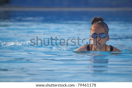 fitness woman swimming in pool - stock photo