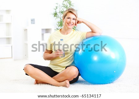 Fitness woman with a bottle of spring water - stock photo