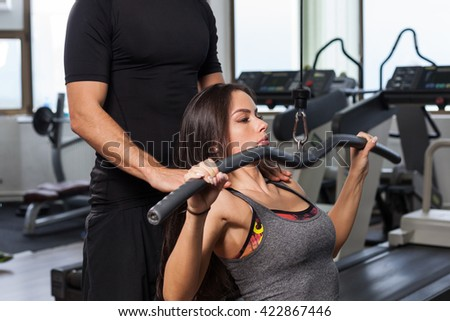 Fitness woman with personal trainer at gym  - stock photo