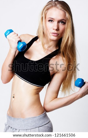fitness woman working out with dumbbells - stock photo