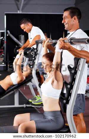 fitness women and personal trainers in gym - stock photo