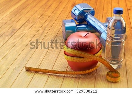 Fitness workout, slimming exercises, weight loss and diet healthy eating concept, blue dumbbells, bottle of mineral water and measure tape around fresh red apple on wooden floor of training class - stock photo