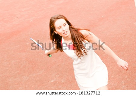 Fitness, young, sport woman playing badminton on playground for leisure time activities - stock photo