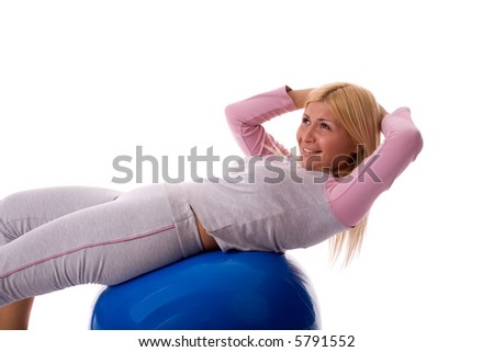 Fitness young woman exercising on pilates ball.