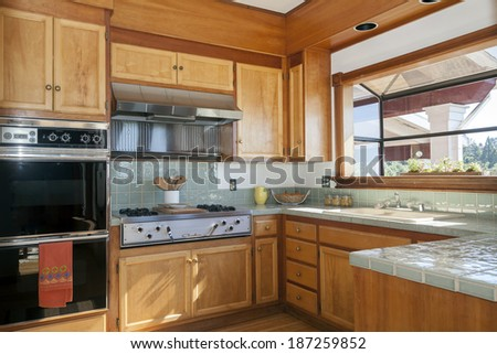Fitted kitchen with lights, built in appliances in California craftsman home - stock photo
