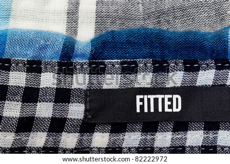 Fitted label on a checker cloth - stock photo