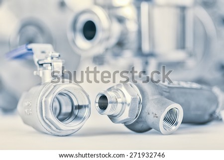 Fittings and ball valve with selective focus on thread fittings - stock photo