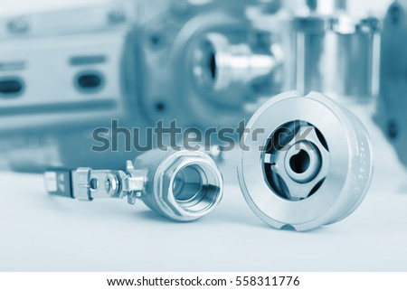 Fittings and ball valve with selective focus on thread fittings. Technical blue colored.