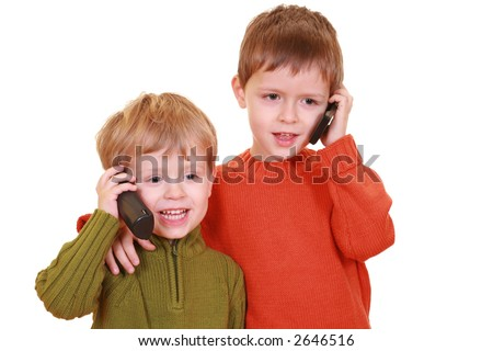 five and three years old boys talking on cellphone isolated on white
